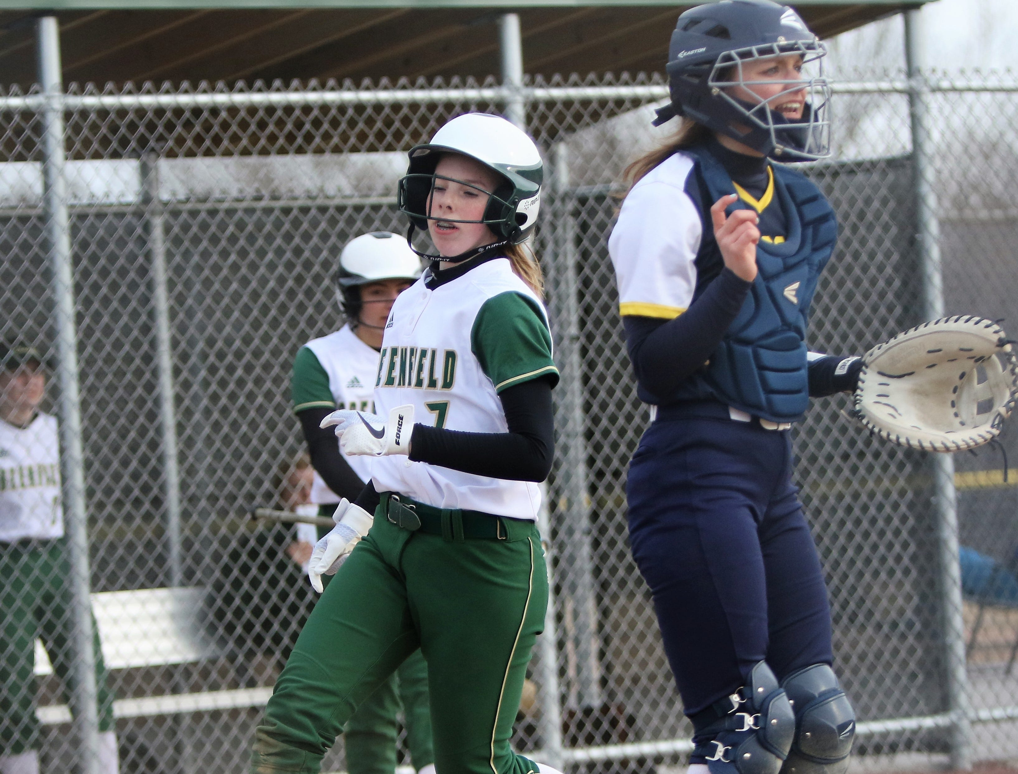 Greenfield's Courtney Bunnow crosses the plate with a run in a game against Whitnall on April 3, 2019.