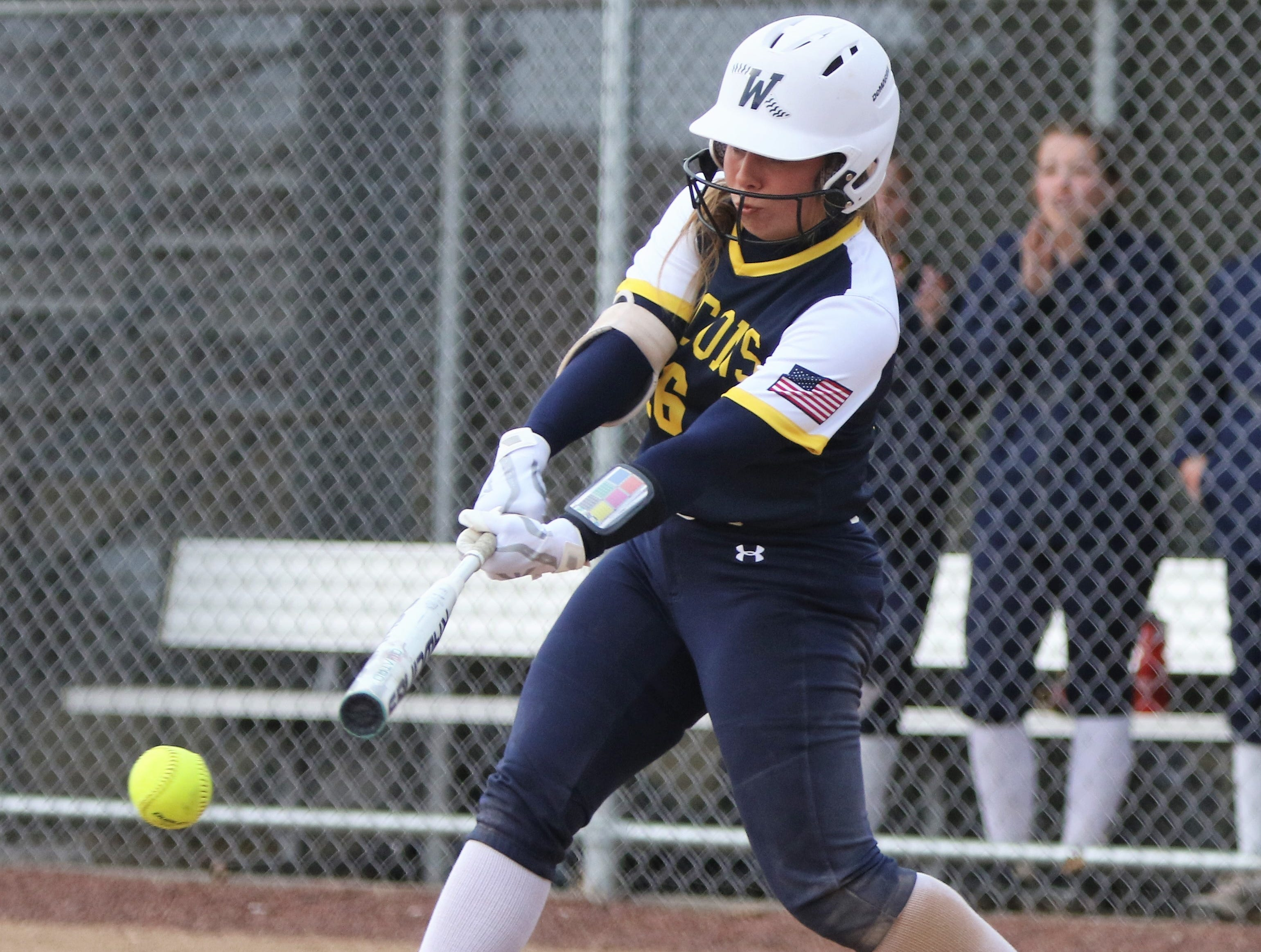 Whitnall senior Haley Wynn connects for a base hit against Greenfield on April 3, 2019.
