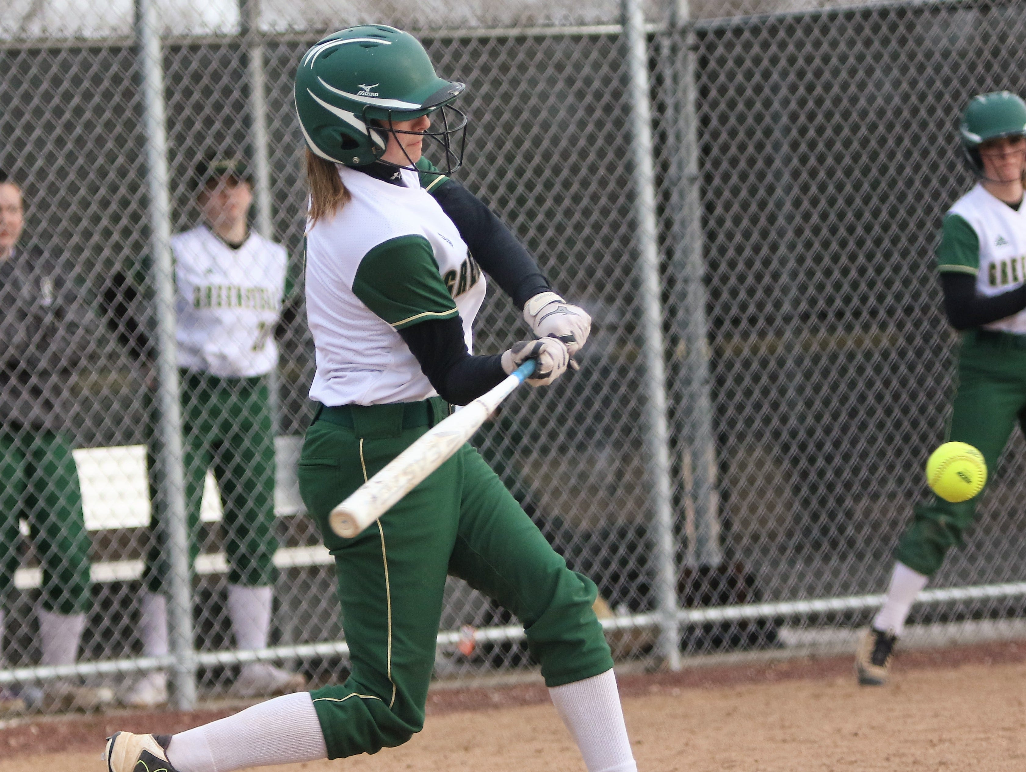 Greenfield junior Allison Mech takes a swing at a pitch during a game against Whitnall on April 3, 2019.