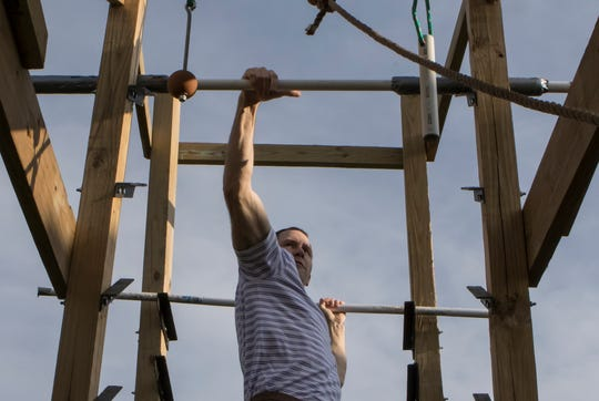 "Billy Branch practices transitions on a salmon ladder while training on his backyard ninja gym in Monroe, La. on April 3. Branch was recently selected to be a contestant on the American Ninja Warrior TV show. ""There's people out there that practice in professional gyms,"" Branch said. ""I'm just out here in Monroe training on my backyard ninja gym."""