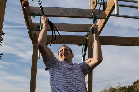 "Billy Branch, a board certified pediatrician, trains on his backyard ninja gym in Monroe, La. on April 3. Branch was recently selected to be a contestant on the American Ninja Warrior TV show. ""I'm not under a lot of pressure to do well,"" Branch said. ""I'm still going to have to go to work on Monday."""
