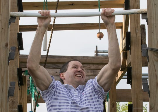 "Billy Branch practices doing a salmon ladder while training on his backyard ninja gym in Monroe, La. on April 3. Branch was recently selected to be a contestant on the American Ninja Warrior TV show. ""There's people out there that practice in professional gyms,"" Branch said. ""I'm just out here in Monroe training on my backyard ninja gym."""