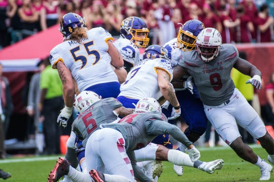 Michael Dogbe of Morris Plains (right, No. 9) finished his Temple University career with 77 solo tackles (19.5 for loss), 8.5 sacks and five forced fumbles in 54 games.