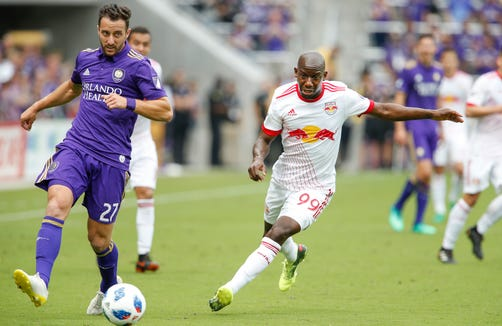 New York Red Bulls forward Bradley Wright-Phillips (99) chases Orlando City defender R.J. Allen (27) during the second half at Orlando City Stadium. Mandatory Credit: Reinhold Matay-USA TODAY Sports