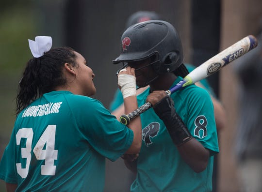 Prattville's Aliyah Hamilton (34) pumps up Ty'Nitra Wilson (12) as she goes up to bat at Prattville High School in Prattville, Ala., on Thursday, April 4, 2019. Prattville defeated Brantley 8-7.
