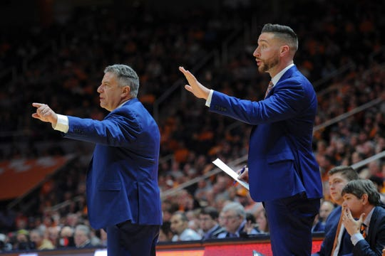 Auburn Tigers head coach Bruce Pearl and son and assistant coach Steven Pearl during a game against Tennessee.