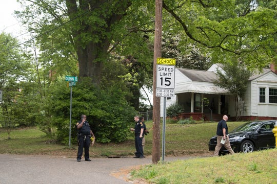 Emergency crews investigate a shooting at the intersection of Mallory Street and Dunn Drive in Montgomery, Ala., on Thursday, April 4, 2019.