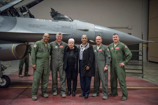 From left, Master Sgt. Curtis Hills, maintenance alert team supervisor with the 113th Wing, Joint Base Andrews, Md., Col. Edward Casey, 187th Fighter Wing Vice Wing Commander, Dannelly, Field, Ala., Marla Andrews, daughter of Tuskegee Airman Capt. Lawrence E. Dickson, 100th Fighter Squadron, 332nd Fighter Group, Gabriel Martin, daughter of Dickson's wingman Lt. Robert L. Martin, a Tuskegee Airman with the 100th FS, Lt. Col. Rob Stimpson, 100th FS commander, 187th FW, and Lt. Col. Nathan Harrold, 377th Fighter Squadron commander, pose with an F-16 Fighting Falcon March 21, 2019, at JBA, Md.
