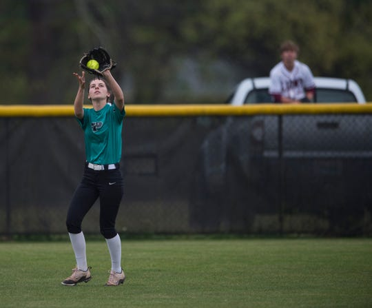 Prattville's Kensley Jarman (11) catches an outfield pop fly at Prattville High School in Prattville, Ala., on Thursday, April 4, 2019. Prattville defeated Brantley 8-7.