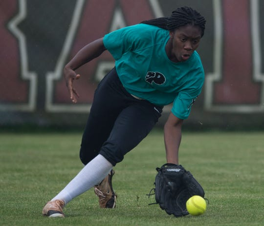 Prattville's Ty'Nitra Wilson (12) scoops up a ground ball at Prattville High School in Prattville, Ala., on Thursday, April 4, 2019. Prattville defeated Brantley 8-7.