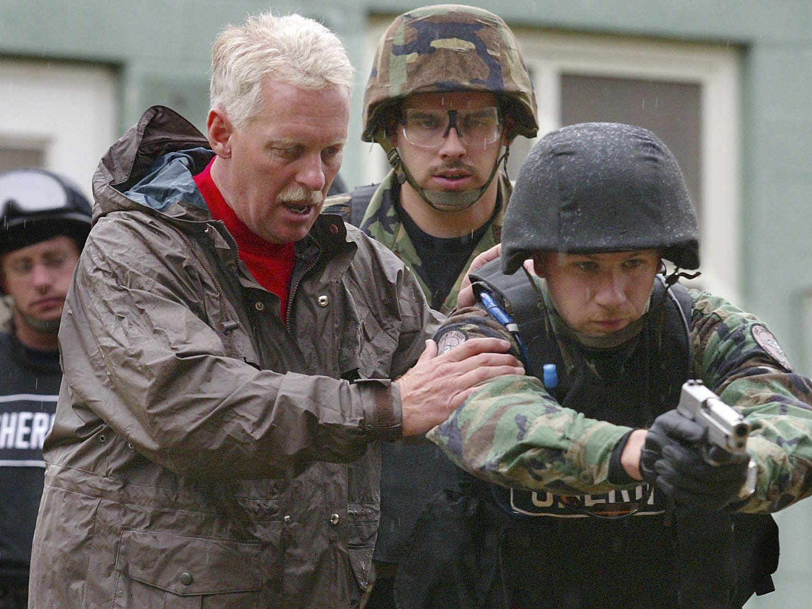 FROM 2004: Sheriff George Sheridan instructs a Grant County police officer on tactical maneuvers during a SWAT school hosted by the Delaware County Sheriff's Department.