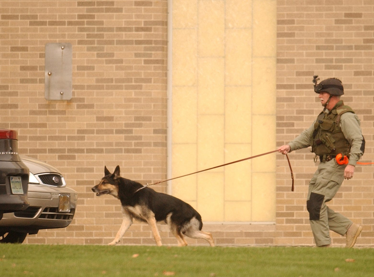 FROM 2007: Delaware County Sheriff George Sheridan and his K-9 partner Heri arrive at  Northside Middle School after a bomb threat was received.