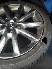 Jarrett Chaiken, Indianapolis, took this photo as proof of the damage an Interstate 69 pothole caused to his tire.