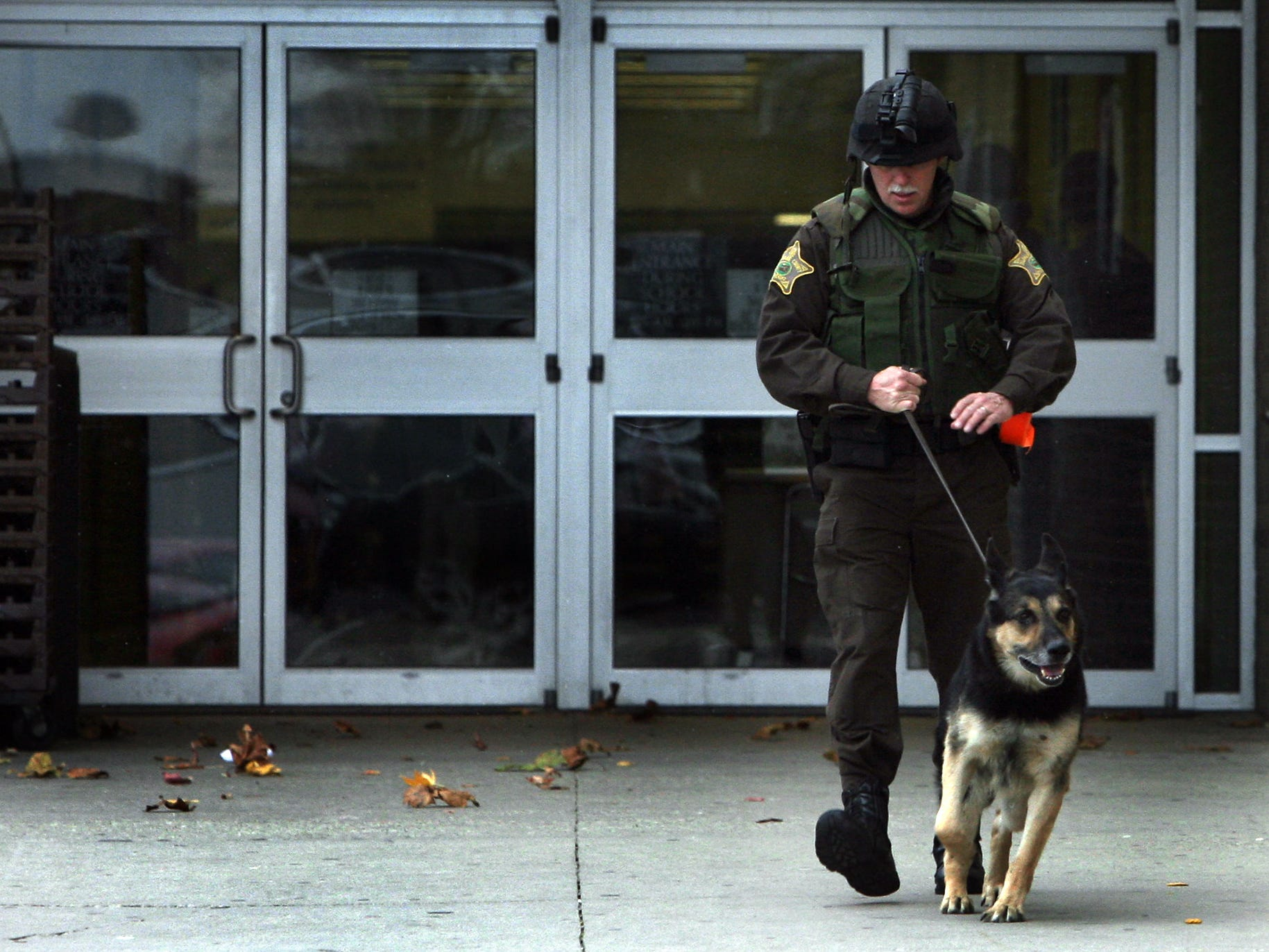 FROM 2007: Delaware County Sheriff George Sheridan leaves Northside Middle School with his K-9 partner, Heri, after searching the building following a bomb threat.