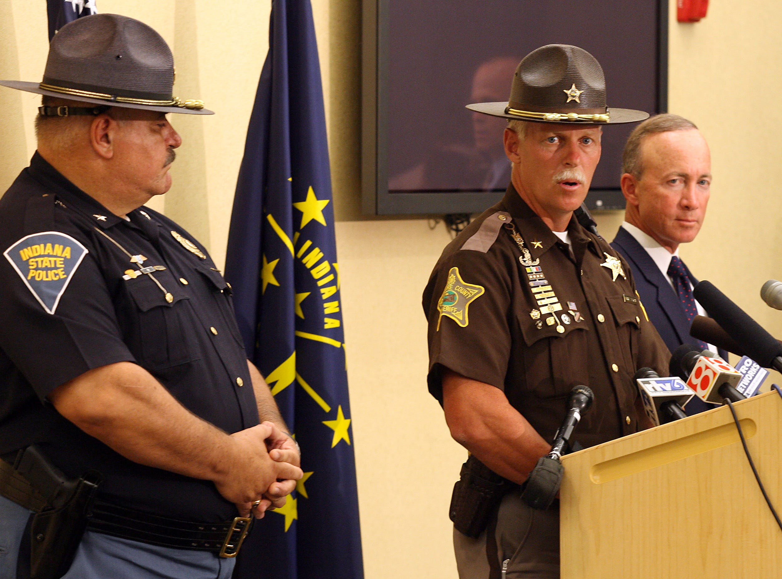 FROM 2006: Delaware County Sheriff George Sheridan announces the arrest of a Gaston teenager, charged in a fatal sniper shooting in southern Indiana. Paul Whitesell, Indiana State Police superintendent left, and Governor Mitch Daniels look on during the Indianapolis press conference.