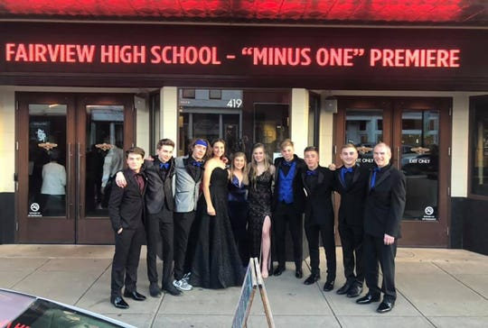 "Cast of ""Minus One"" does a quick pose with the marquee."