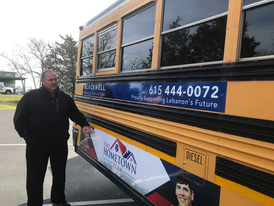 Lebanon Special School District Transportation Director Richard Anderson shows an ad now on one of the district's school buses.