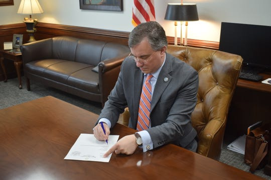 Assistant Majority Leader Ron Gant signs a notice of recall on the Human Life Protection Act.