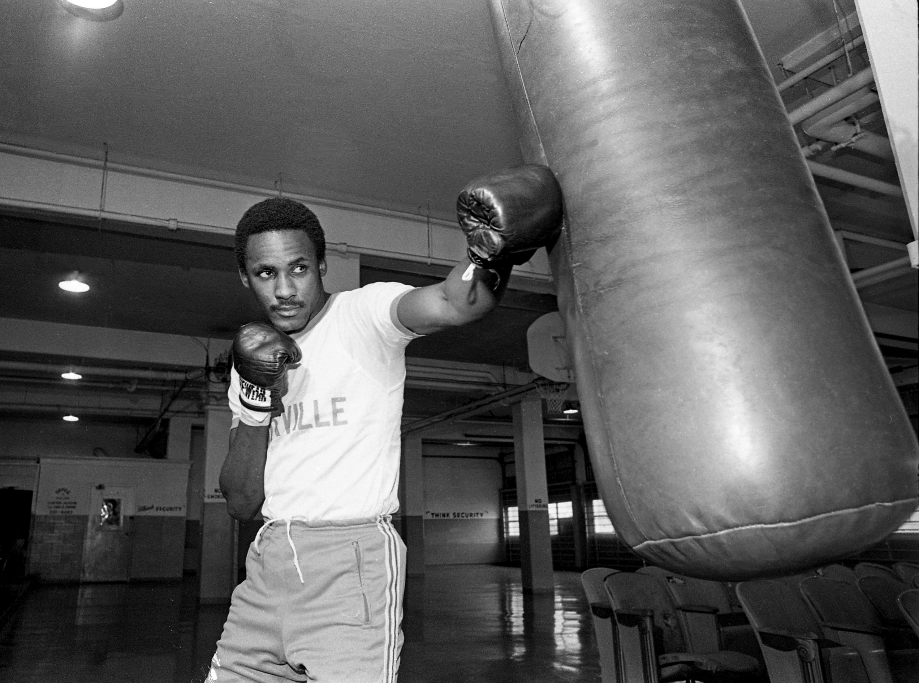 Boxer Mike McCallum, a 22-year-old Jamaican who has been trying to become an American citizen for nearly three years, is working out at the Metro Sheriff Department gym April 4, 1979, for this summer's Pan American Games. McCallum hopes to win a gold medal in boxing for himself and the United States in the 1980 Olympic Games.