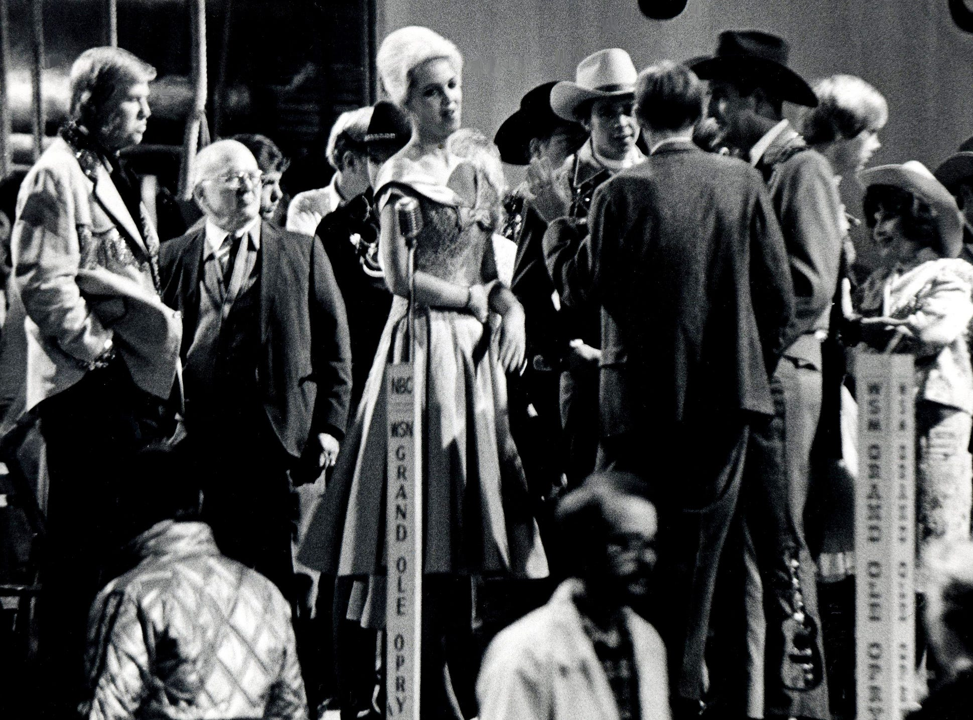 """Onstage at the Ryman Auditorium on April 10, 1979, the look of the Grand Ole Opry circa 1961 was recreated, as costumed actors and extras rehearsed the informal milling around that has always marked an Opry performance for taping of the """"Coal Miner's Daughter"""" movie."""