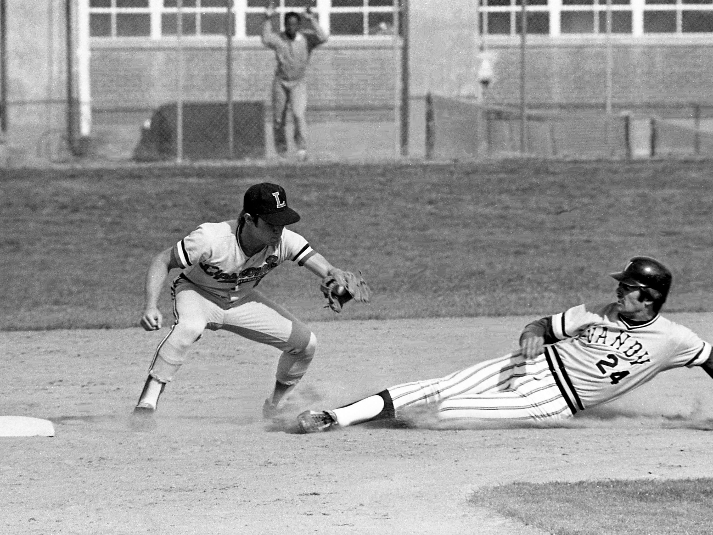 Lipscomb College second baseman Terry Moore, left, is ready to tag Vanderbilt University baserunner Mark Elliott out on a steal attempt to end the Commodores' third-inning rally. The Lipscomb machine rolled right over Vanderbilt 8-2 at their Onion Dell Field on April 19, 1979.