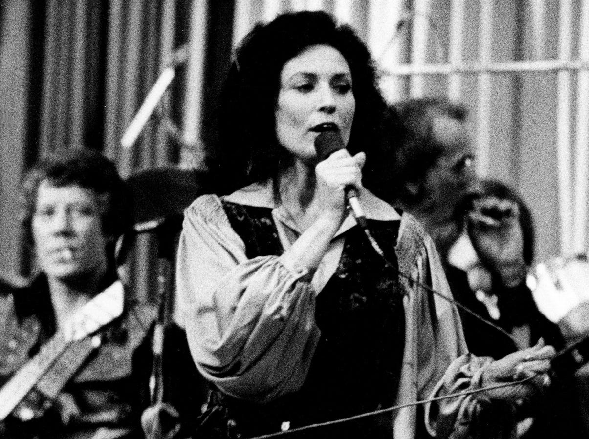 """Loretta Lynn wows the Municipal Auditorium crowd with a surprise performance during the filming of one of the biggest scenes in """"Coal Miner's Daughter"""" in Nashville on April 24, 1979. Her first song? It was same as the title of the movie."""