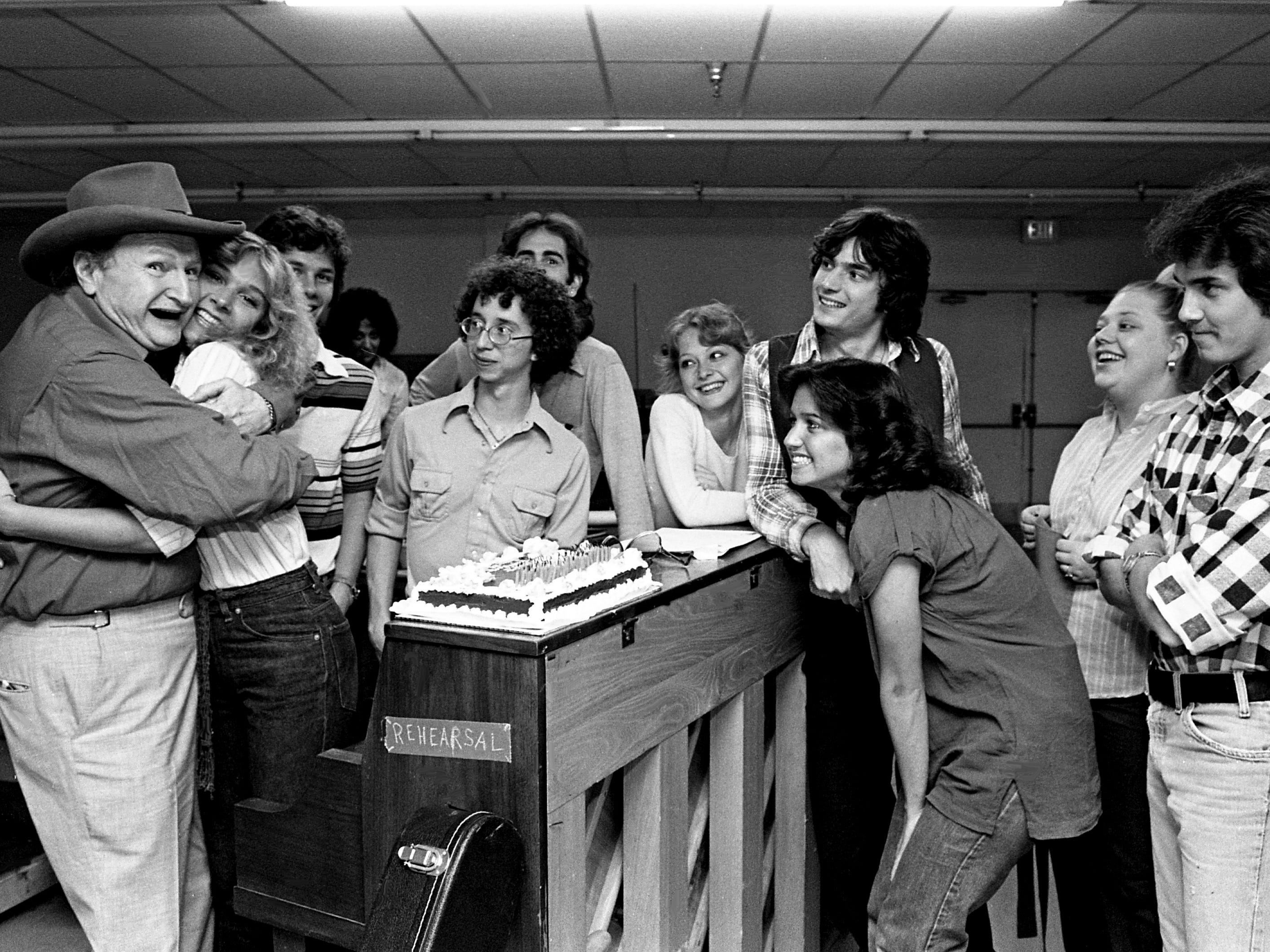 """Former funny vampire Al Lewis, left, got a birthday hug from Cindy Rhodes when she and other cast members interrupted rehearsals for """"Big Al's Doggs"""" with a surprise 69th birthday party April 30, 1979. The first episode of the musical-situation-comedy was  taped for syndication at Opryland."""