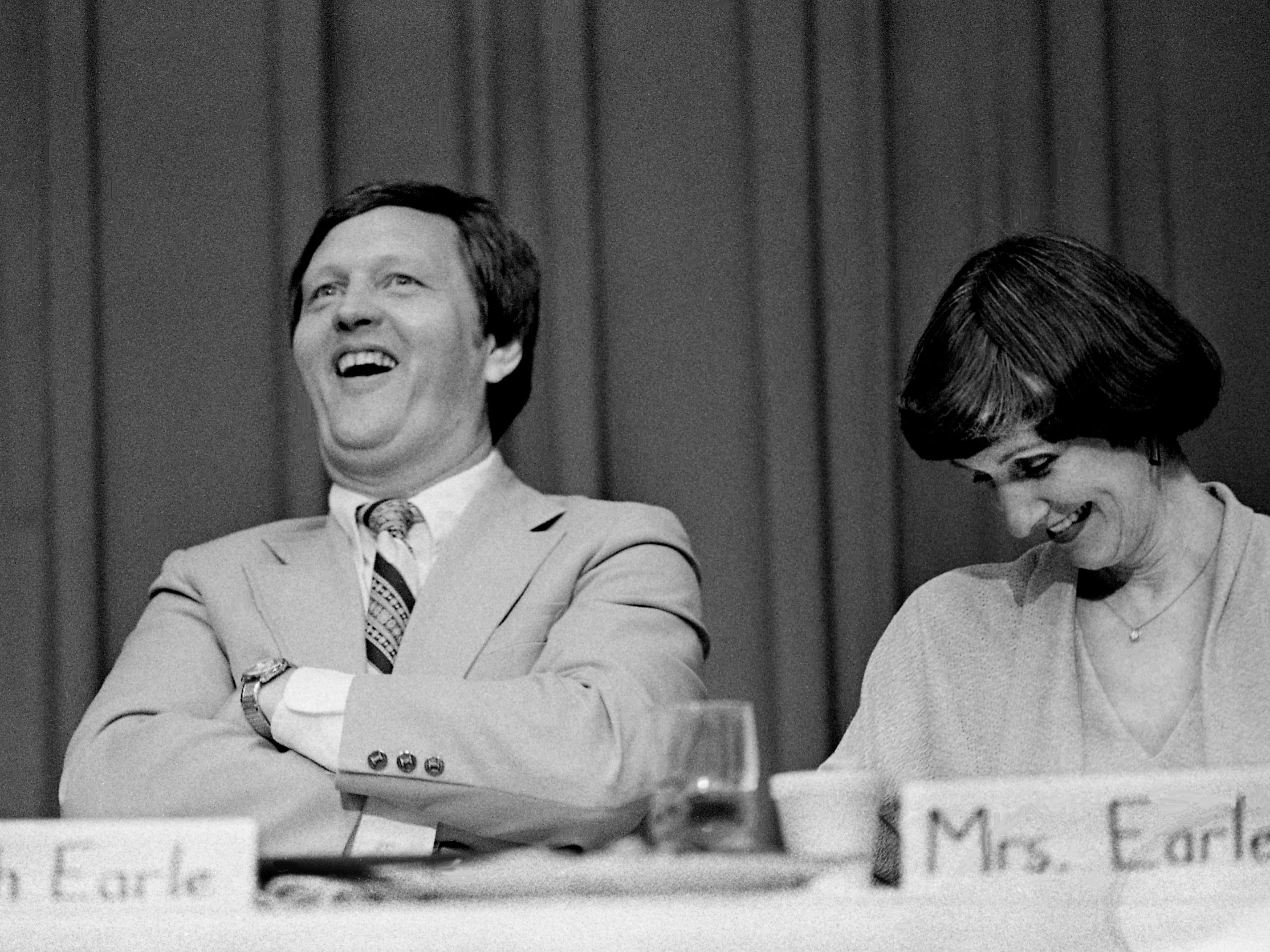 Former Middle Tennessee State University head basketball coach Jimmy Earle, left, who retired after the season ended, lets out a hearty laugh as friends, members of the media and long-time coaching associates roast and toast him during an appreciation testimonial on campus April 26, 1979. Enjoying the moment is Earle's wife, Frances.