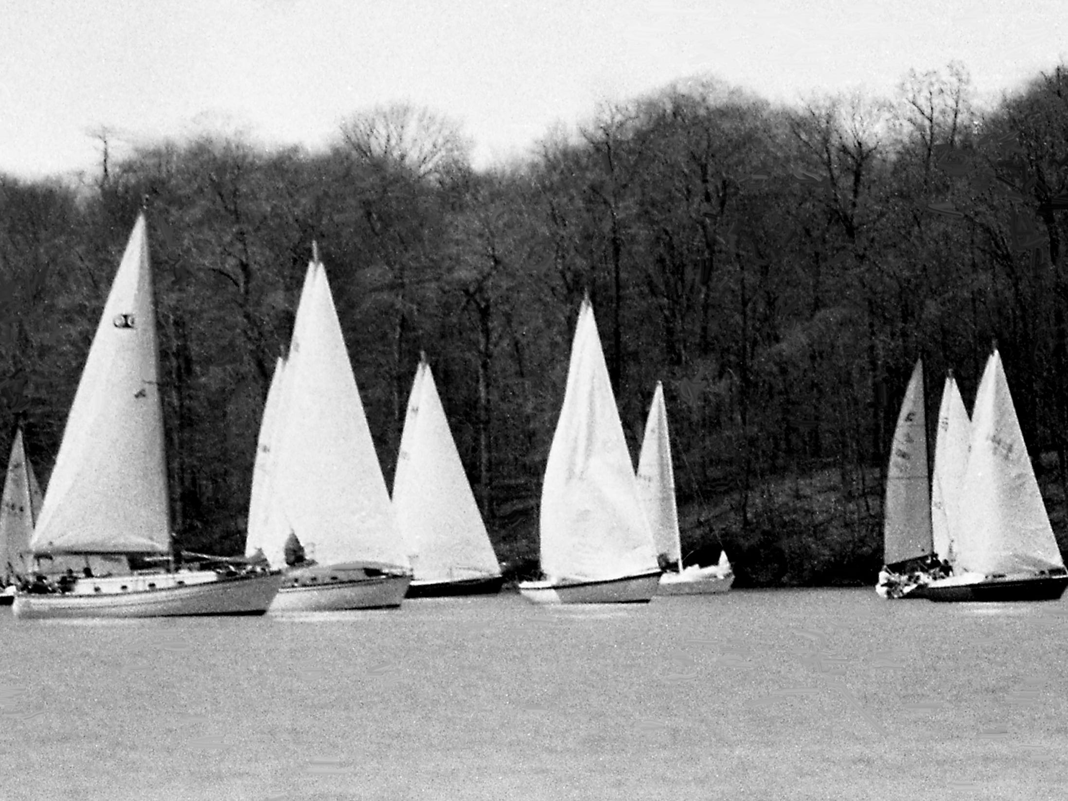 These boats set sail with high hopes on their way to the race course April 7, 1979, to compete in the 26th annual Tennessean Regatta. They eventually ran out of steam – air, rather – and never got to start the race. It marked the first cancellation ever. The two-day regatta will condense into a one-day event and try again the next day.