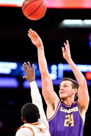 Lipscomb guard Garrison Mathews (24) shoots over Texas guard Courtney Ramey (3) during the first half of their NIT Championship Game at Madison Square Garden Thursday, April 4, 2019 in New York, N.Y.