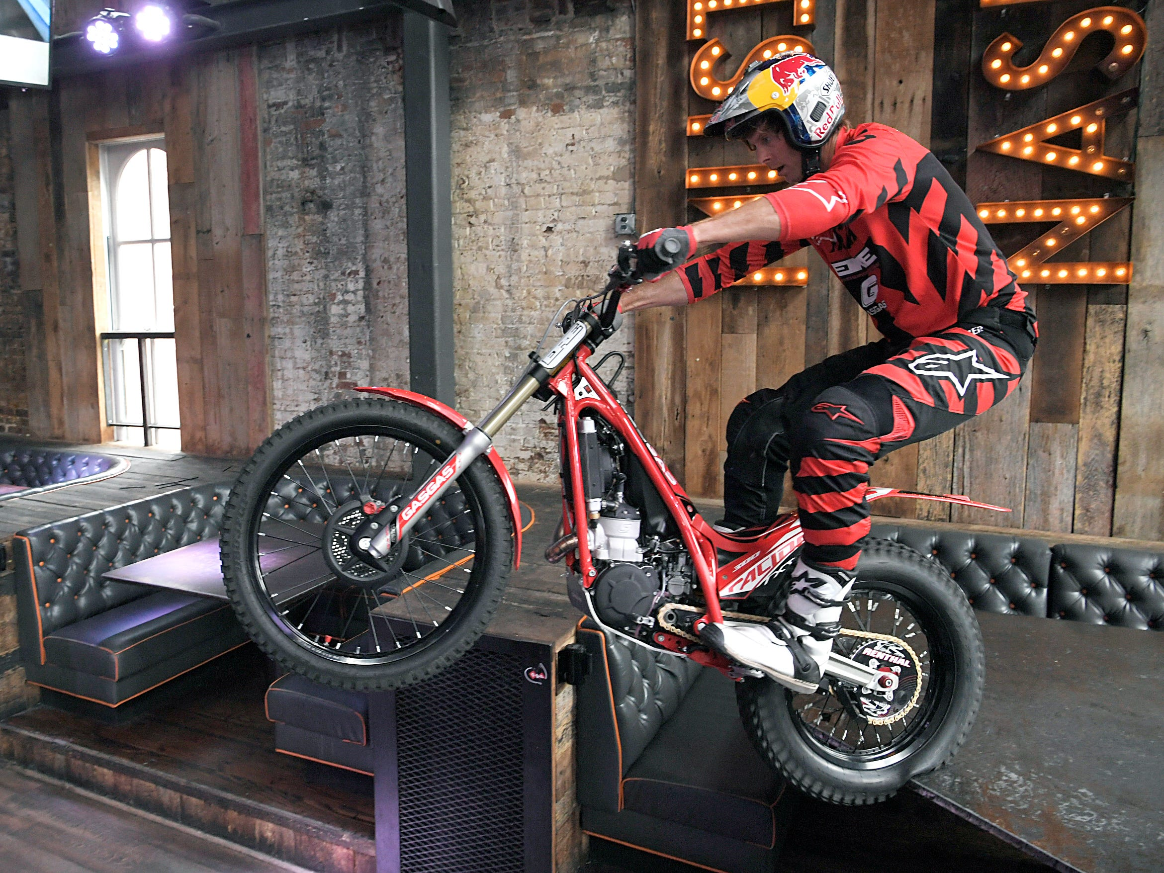 Trial motorcyclist Geoff Aaron performs stunts inside Dierks Bentley's Whiskey Row on Broadway on Thursday, April 4, 2019. The trials and endurocross legend is in town for the Motocross-Supercross event.