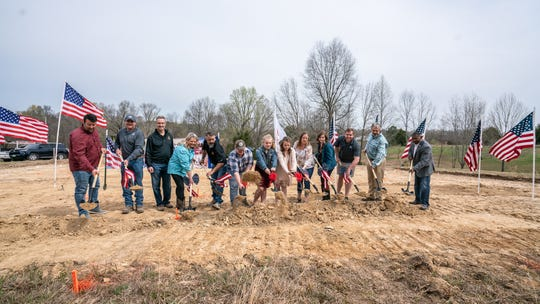 Representatives from Operation FINALLY HOME, Building Solutions by Spann, LLC, and the Home Builders Association of Middle Tennessee break ground on a mortgage-free home Thursday in Charlotte, Tenn. for U.S. Army Sergeant First Class Josh Ferguson.