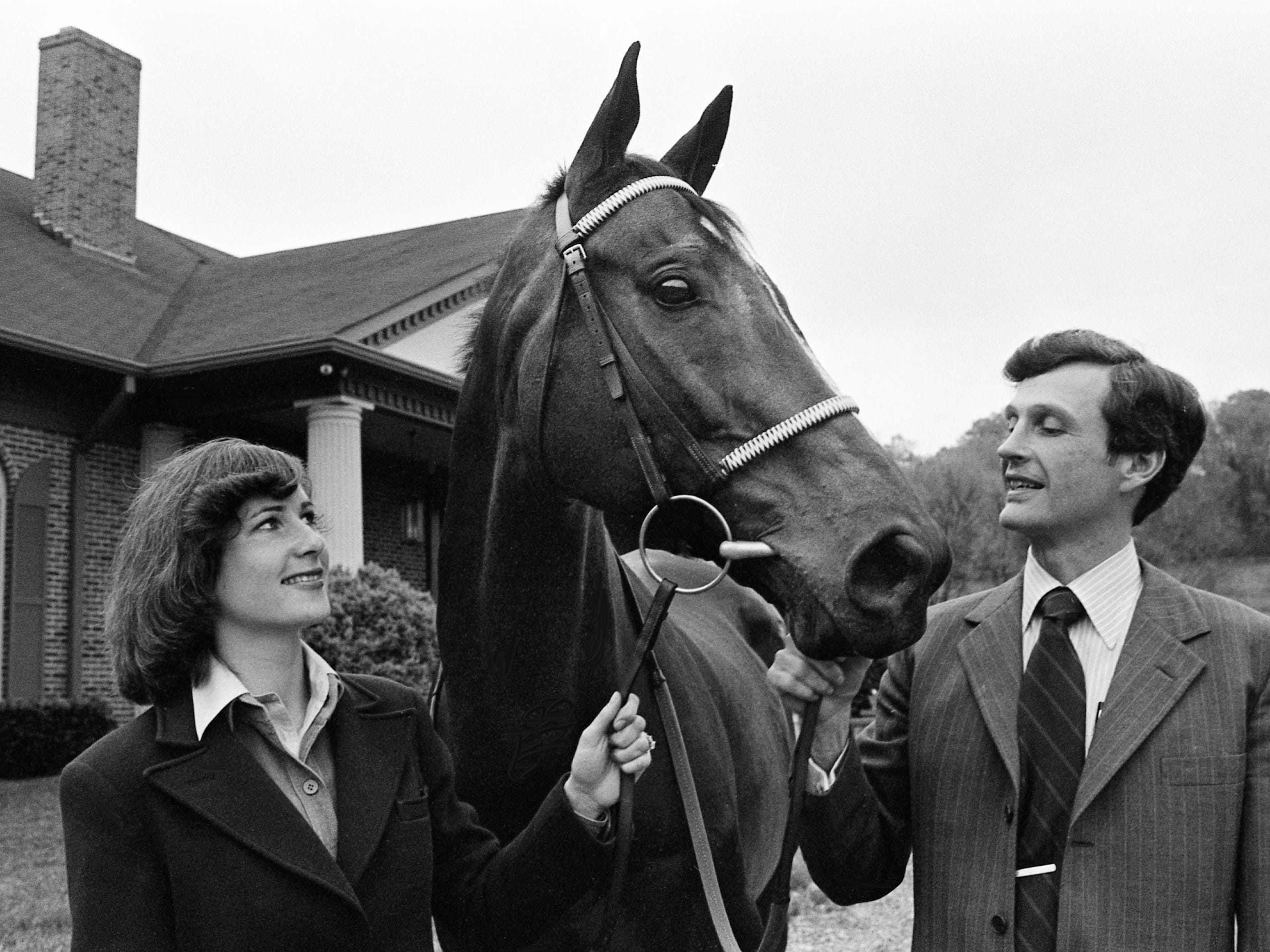 Jane and George Sloan, perhaps the finest husband-wife steeplechase team in the country, check out one of their horses, Prime Motive, April 24, 1979. They may enter the horse in the Iroquois Steeplechase on May 12.