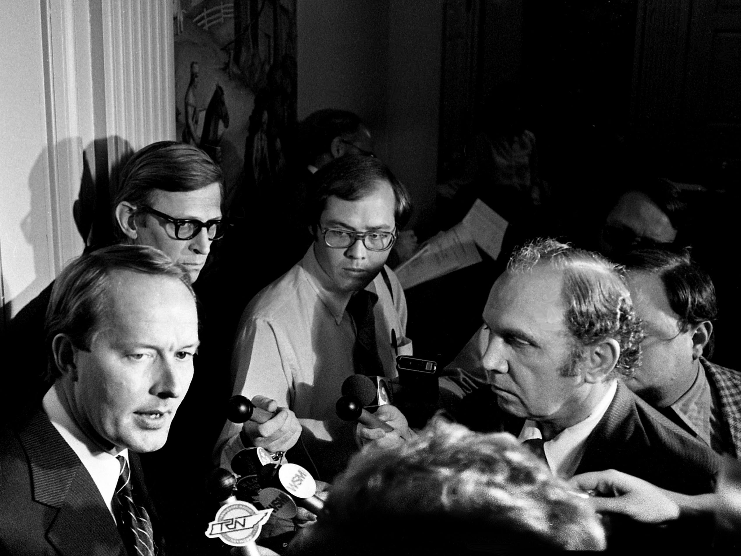 Gov. Lamar Alexander, left, announces his intention to accept the recommendation of State Attorney William Leech, behind the governor, to appeal the Court of Criminal Appeals decision affirming former Gov. Ray Blanton's granting of executive clemency to three state prison inmates during a press conference at the state Capitol on April 10, 1979.