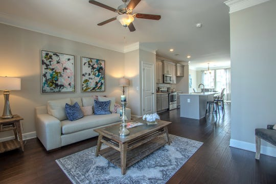 Open floor plans are a hallmark of Regent Homes, with the kitchen open to the living room.