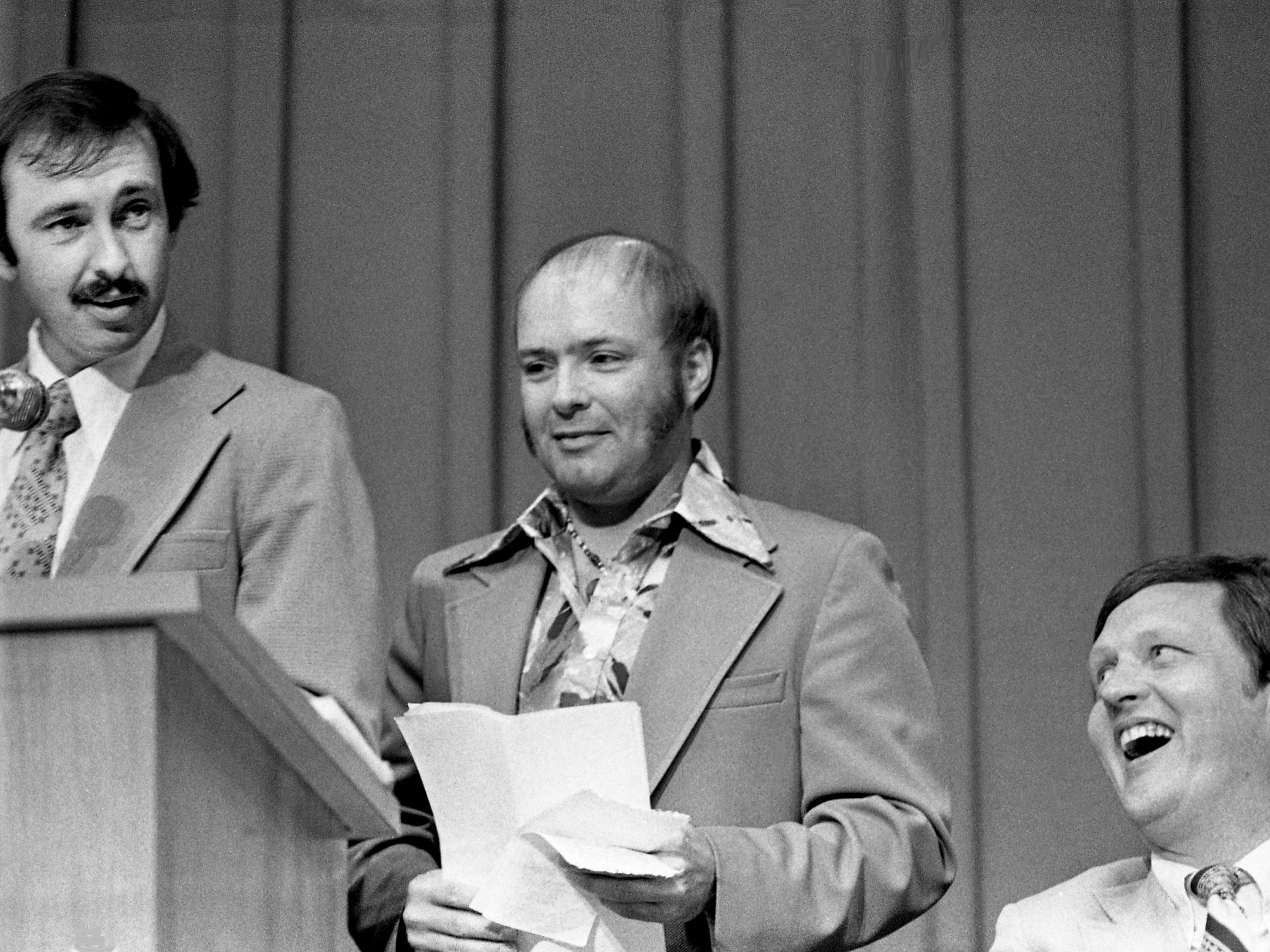 Former Middle Tennessee State University head basketball coach Jimmy Earle, right, who retired after the season ended, lets out a hearty laugh as The Tennessean sportswriter Larry Woody, left, and Nashville Banner sportswriter Joe Caldwell roast and toast him during an appreciation testimonial on campus April 26, 1979.