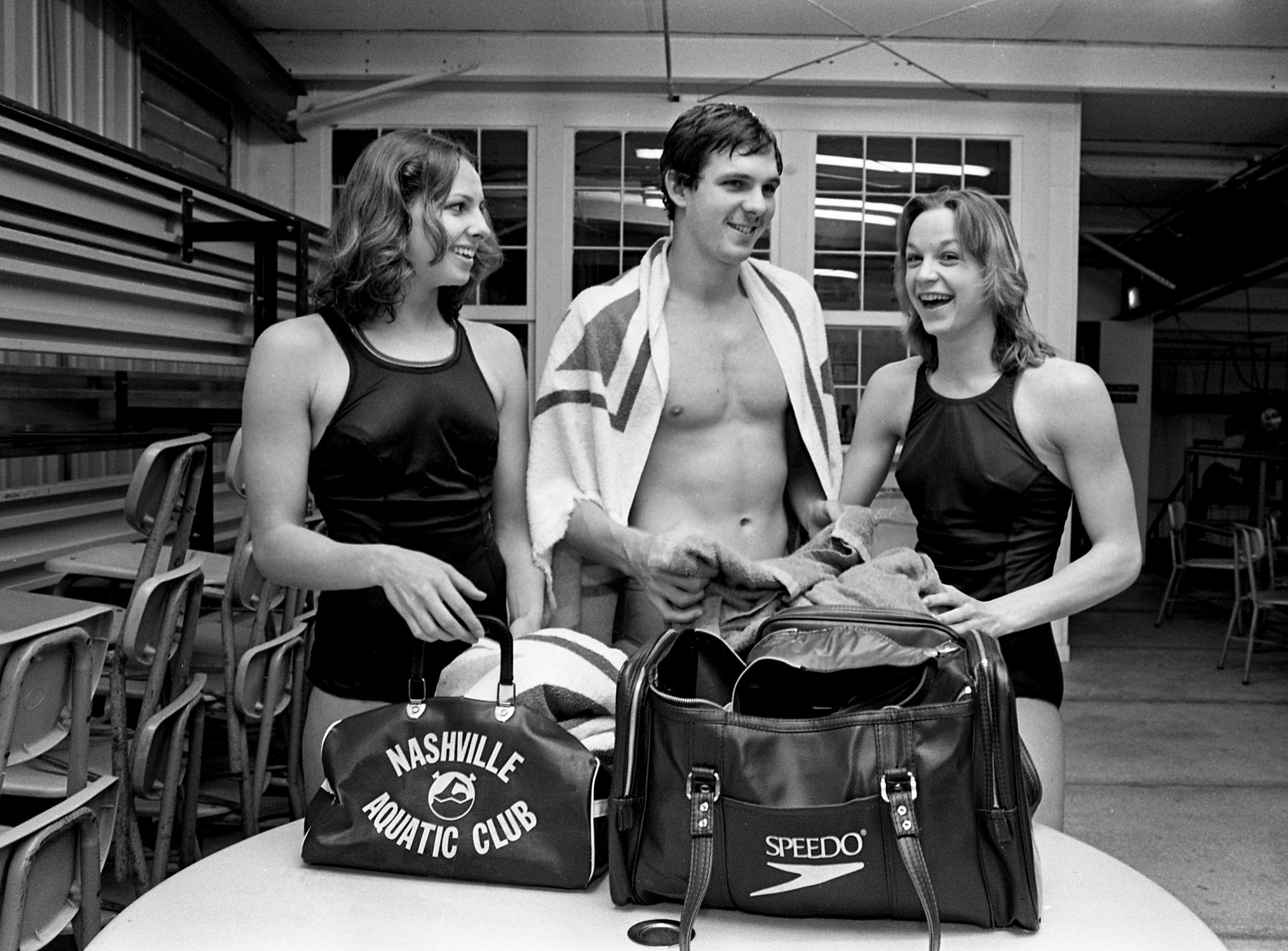 Swimmers Macie Phillips, left, Kent Martin and Andrea Cross of the Nashville Aquatic Club have their bags packed at the club's pool April 6, 1979. The trio with 11 other club swimmers will be participating in the upcoming AAU Short Course National Championships in East Los Angeles.