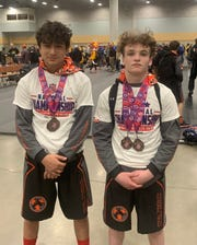 Kendrick Curtis on the left and Malachi Bennett at Lee Pamulak MS National Duals representing Team TN.