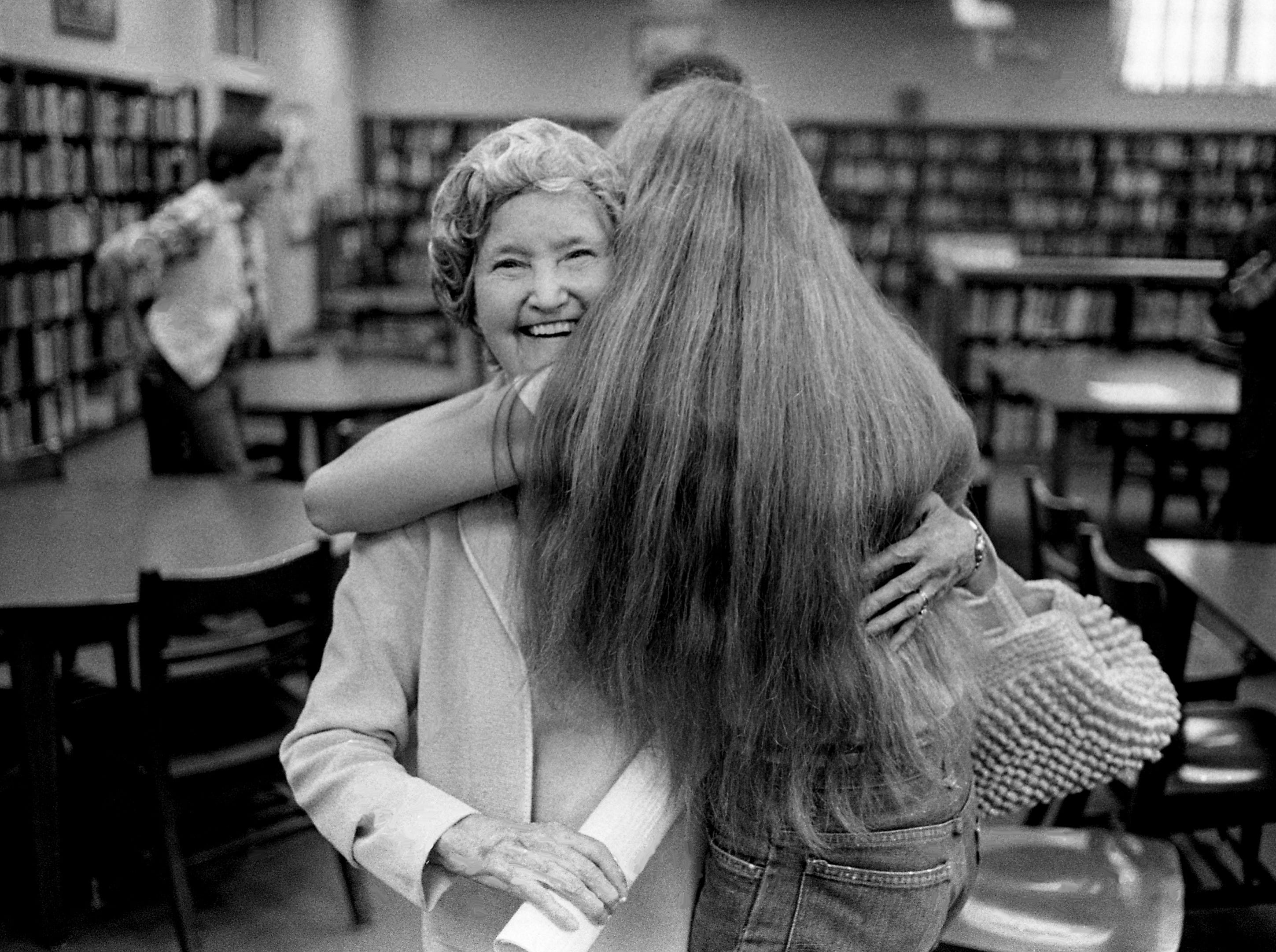 """Mrs. Mona Prowell, left, and Mount Juliet High School student Lisa Lafevor embrace jubilantly as the school day ends April 25, 1979. Senior citizens are making three-day visits to the Wilson County schools for the """"Senior-Senior Days"""" program."""
