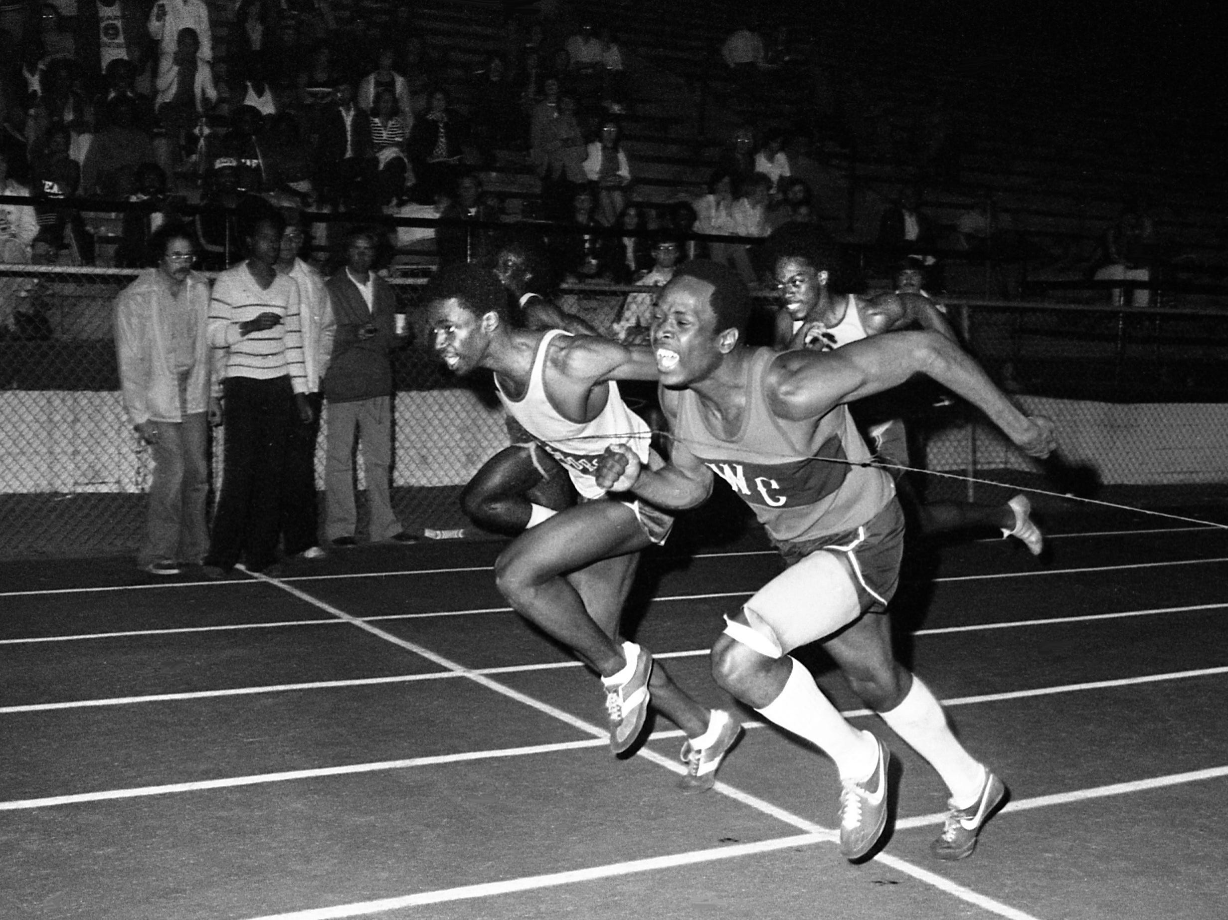 Mickey Avery, right, of Whites Creek High and Jerome Wilson of Hillsboro High stretch the wire at the finishes of the 110-yard high hurdles during the Optimist Relays at Overton High School on April 21, 1979. Avery was declared the winner over Wilson.