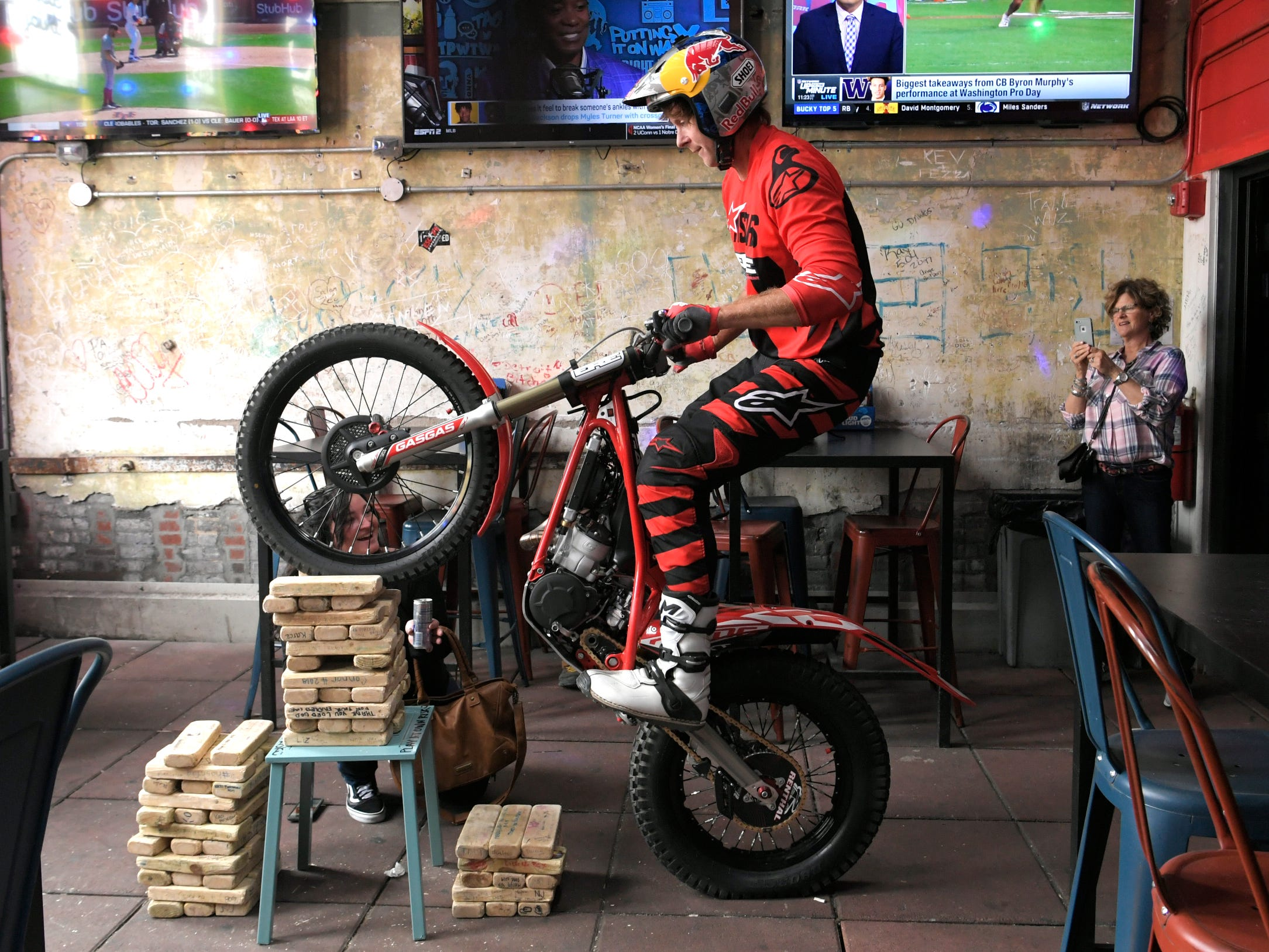 Trial motorcyclist Geoff Aaron performs stunts in Nashville's downtown Broadway bar on Thursday, April 4, 2019. The trials and endurocross legend is in town for the Motocross-Supercross event