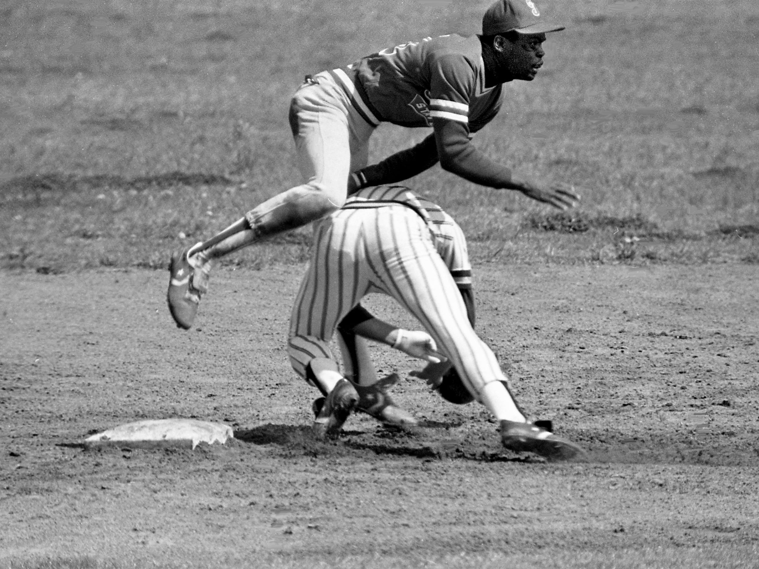 Tennessee State second baseman Kirk Forbes tumbles over a sliding Vanderbilt base runner Mike Pike, who is making an effort to break up a double play after being forced out at second base. The host Vanderbilt defeated Tennessee State 15-4 at McGugin Field before later edging Austin Peay 4-2 in an unusual doubleheader April 3, 1979.
