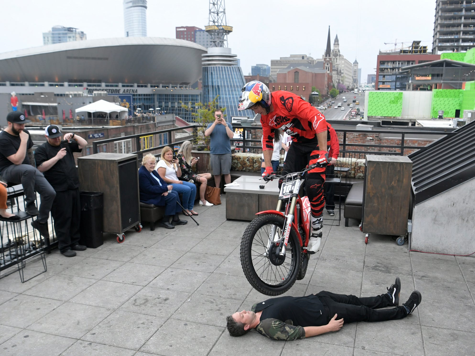 Trial motorcyclist Geoff Aaron performs stunts on the rooftop of Dierks Bentley's Whiskey Row on Broadway on Thursday, April 4, 2019. The trials and endurocross legend is in town for the Motocross-Supercross event.