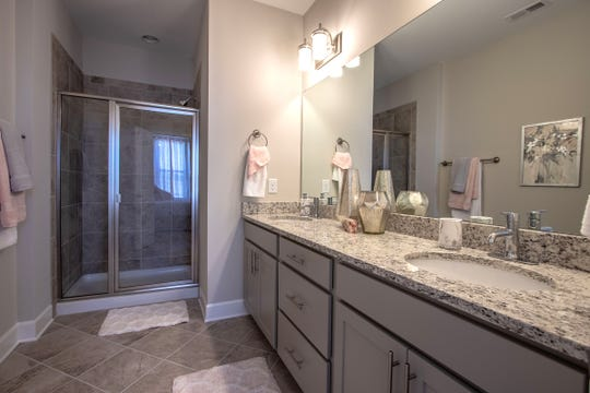 A luxury shower replaces the bath tub in this Regent Homes master bath.