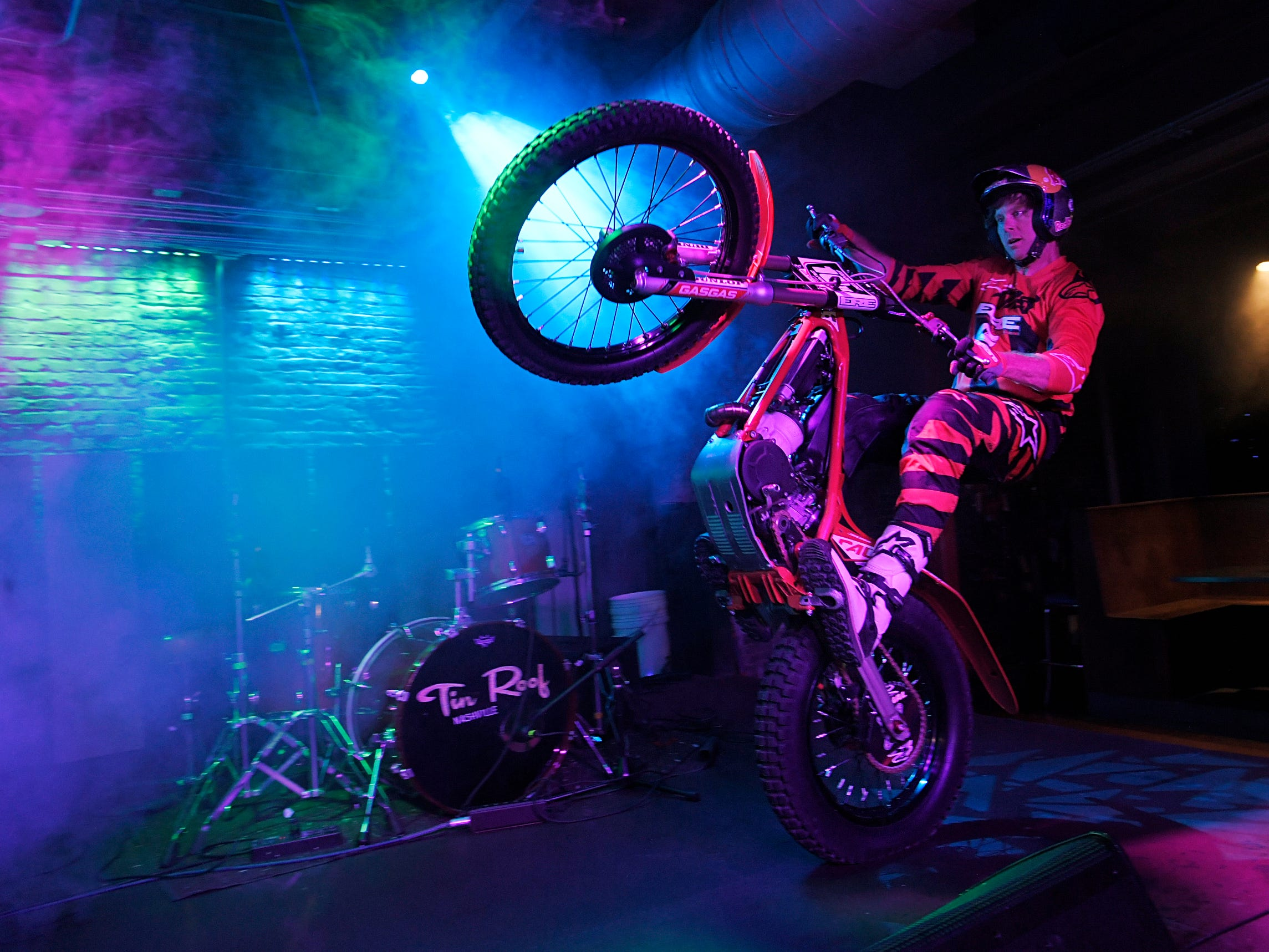 Trial motorcyclist Geoff Aaron pops a wheelie on the stage at the Tin Roof on Broadway on Thursday, April 4, 2019. The trials and endurocross legend performed stunts in Nashville bars ahead of the Motocross-Supercross event on Friday.