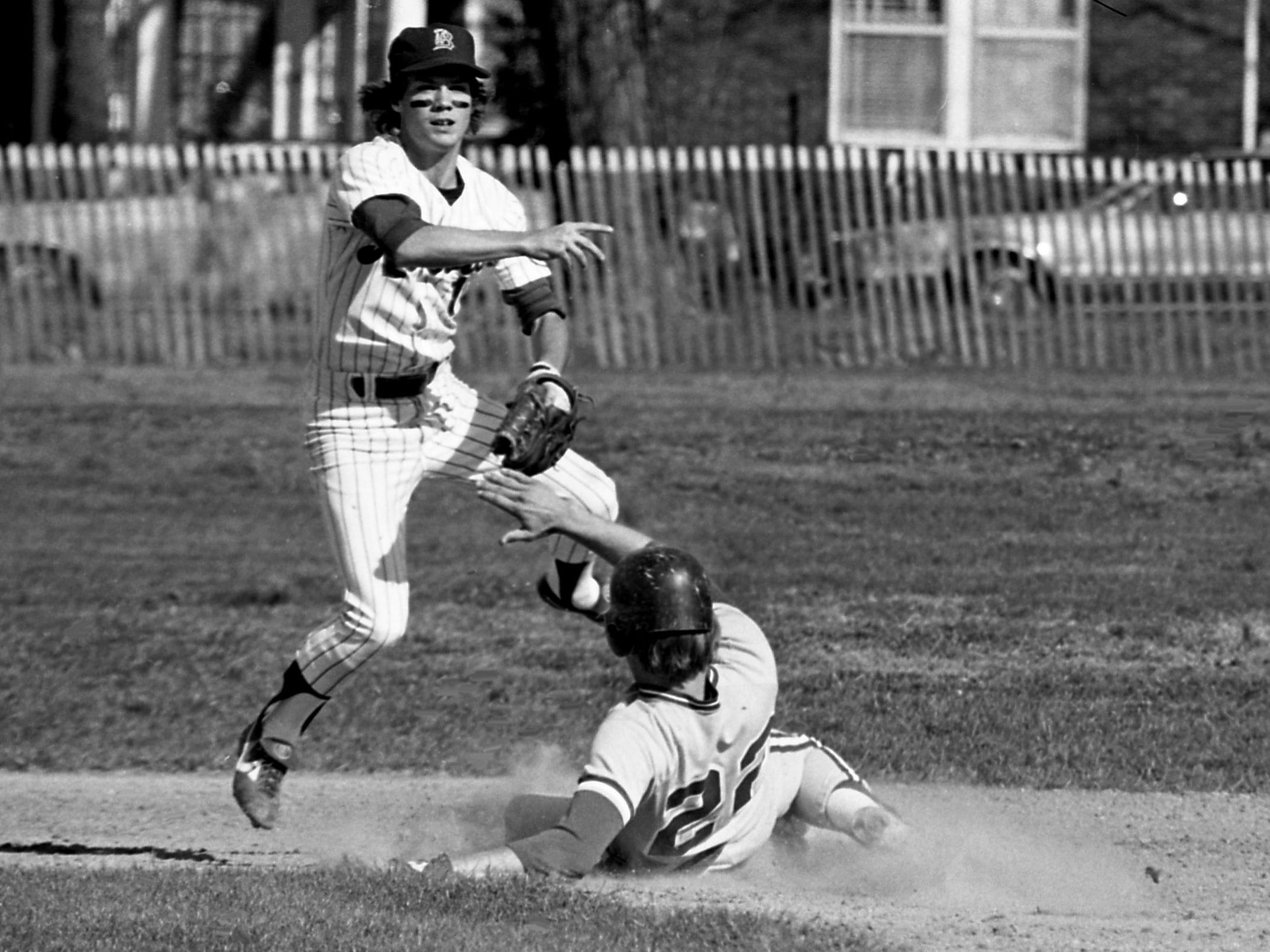 Belmont College second baseman Doug Clunan gets his throw away to first base as Trevecca College base runner Greg Gunnells slides into the bag. The double play attempt failed, but Belmont won their city battle 8-0 on their field April 5, 1979.