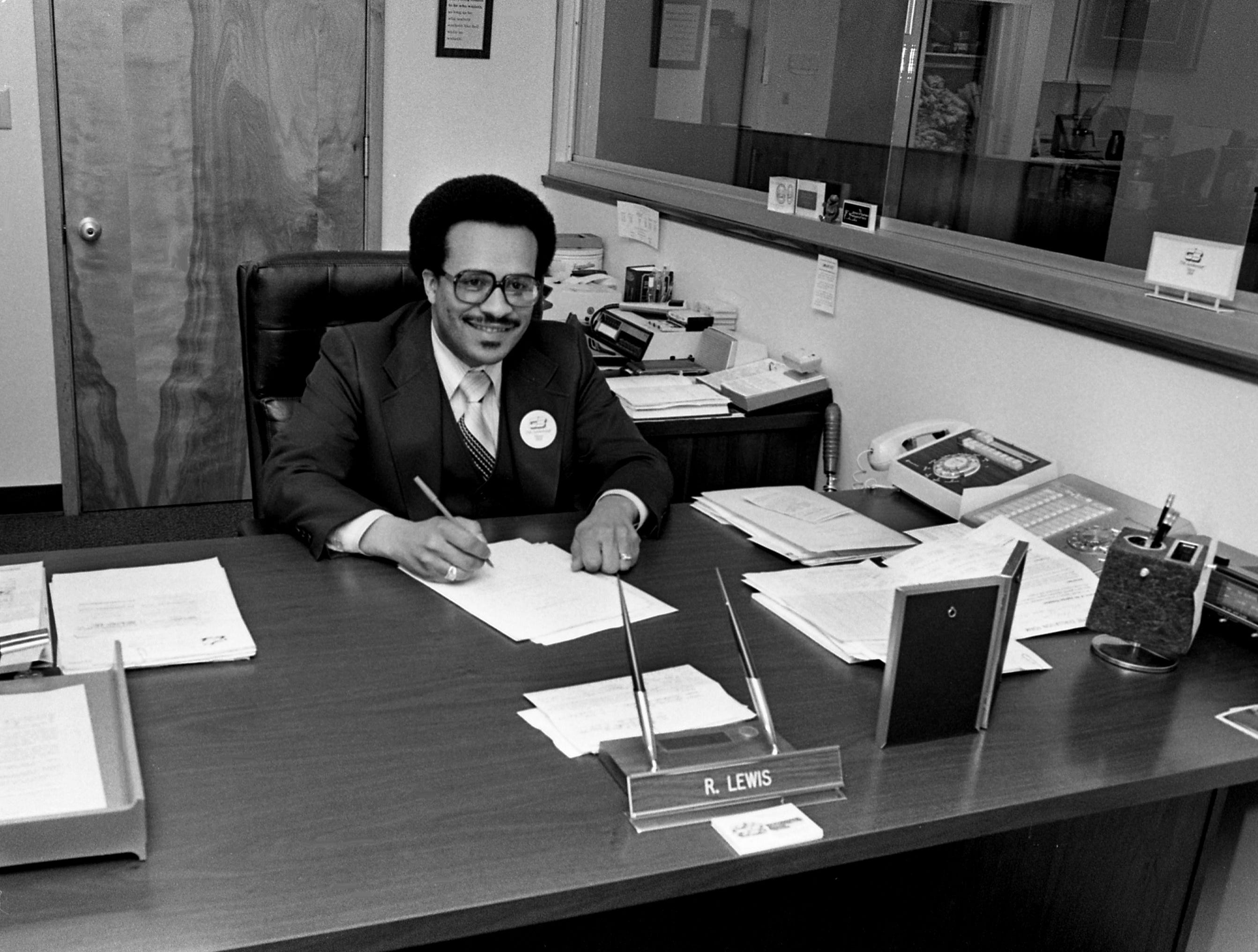 Richard Lewis, 34, president of the Citizens Savings Bank and Trust Company, works at his desk on April 10, 1979. He has been at Citizens for a year after serving in several capacities for Third National Bank.