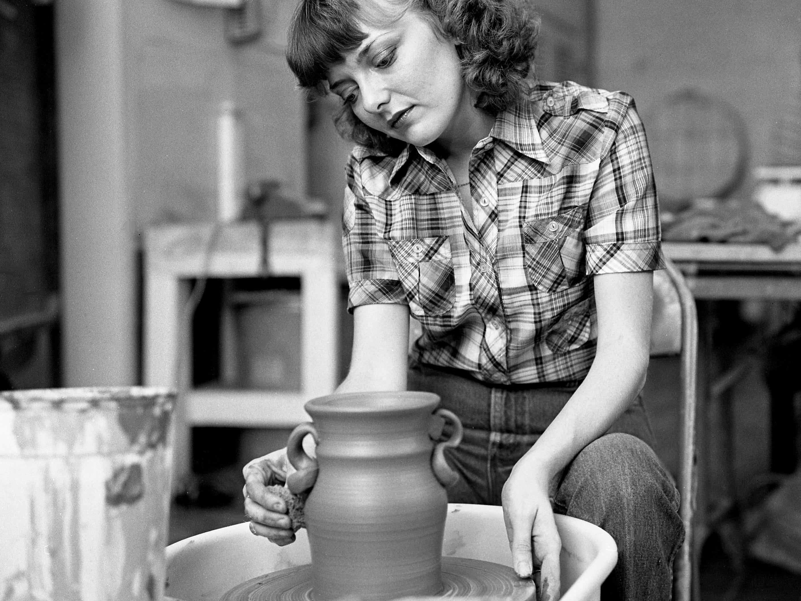 Middle Tennessee State University art student Kay Davenport is working on a pot at the Centennial Park Arts Center on April 19, 1979. She and other fellow students will be demonstrating the potter's art during the upcoming Tennessee Craft Fair in the park.