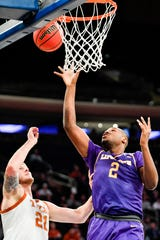 Lipscomb center Ahsan Asadullah (2) shoots against Texas forward Dylan Osetkowski (21) during the first half of their NIT Championship Game at Madison Square Garden Thursday, April 4, 2019 in New York, N.Y.