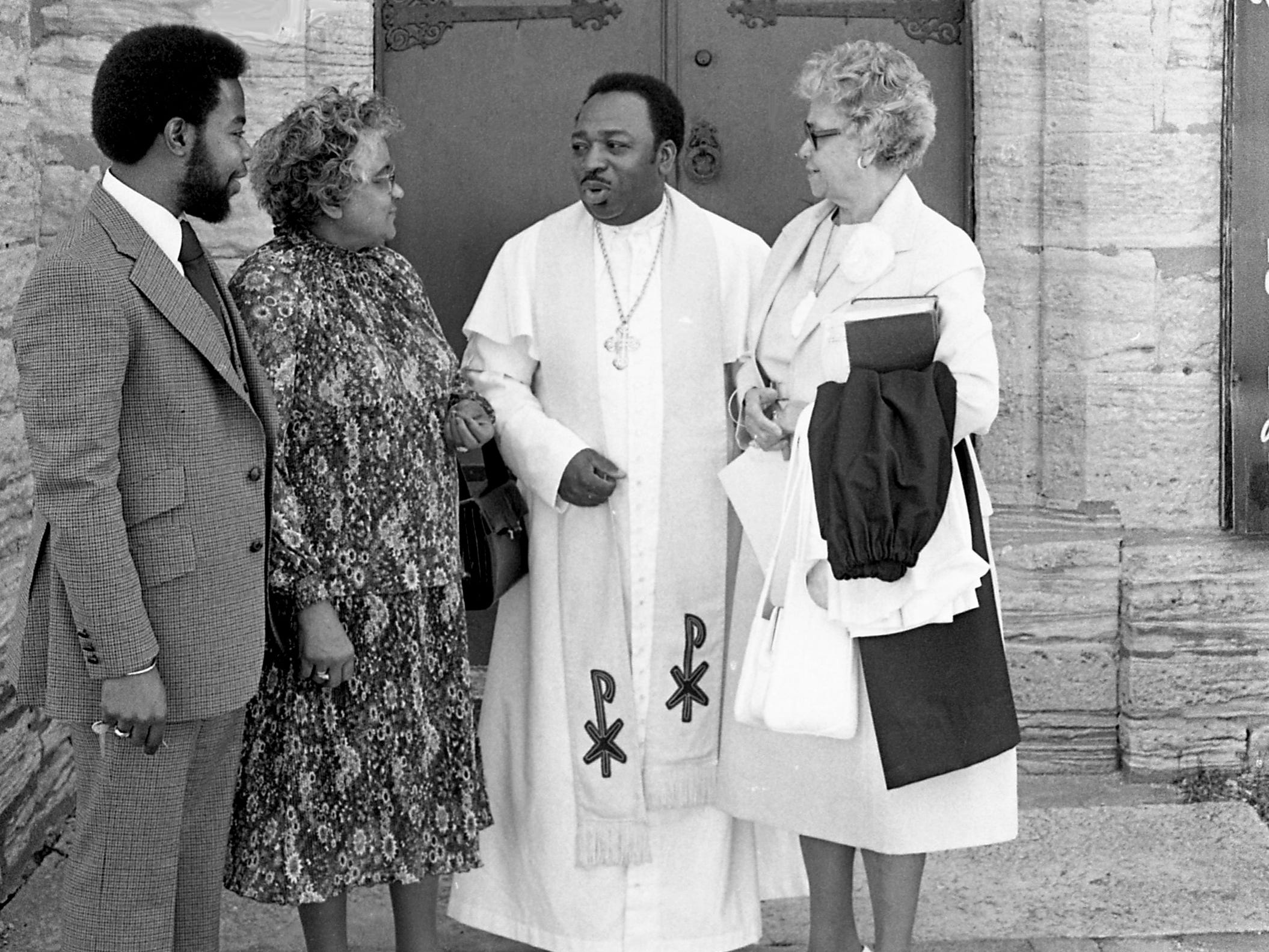 The Rev. Crayton T. Dudley, rector, second from right, shares a moment with Angus Dudley, left, Mrs. Jeanette Forrester and Mrs. Grafta M. Looby during Easter service at the Holy Trinity Episcopal Church at 615 6th Ave. S., on April 15, 1979.